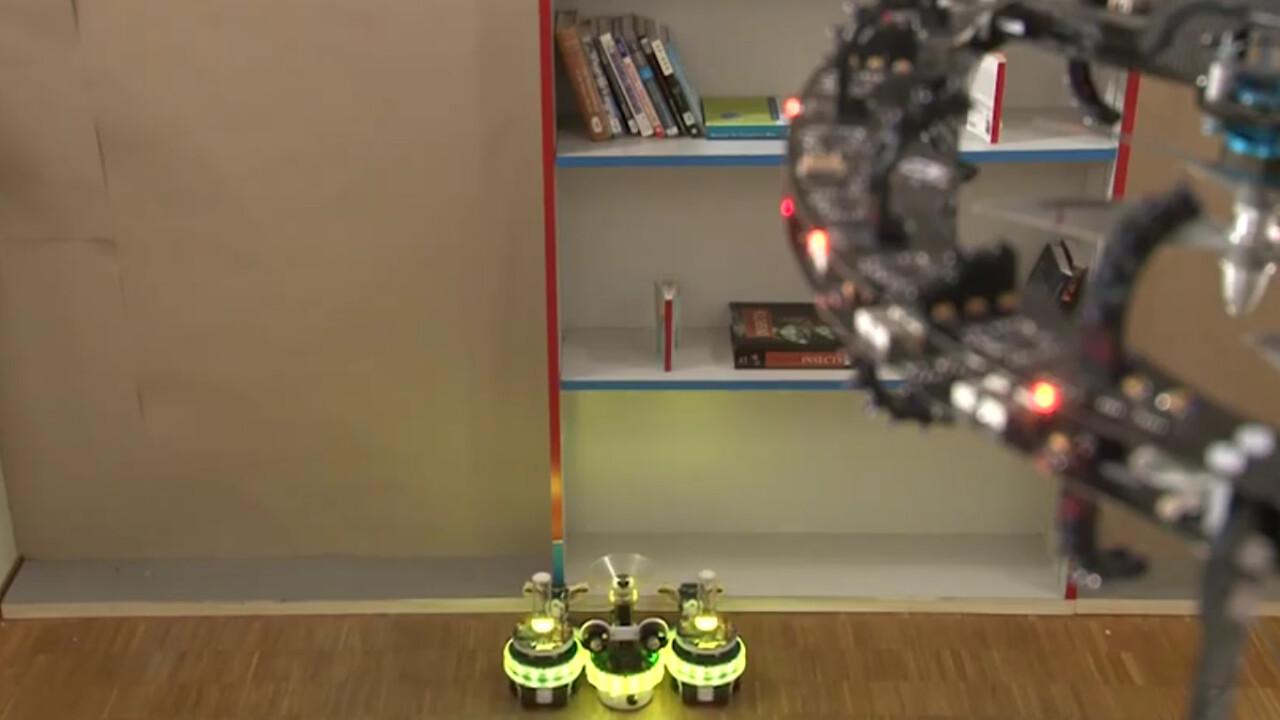 Award-winning Swarmanoid bots: Eye-bots, hand-bots, and foot-bots communicate to work together