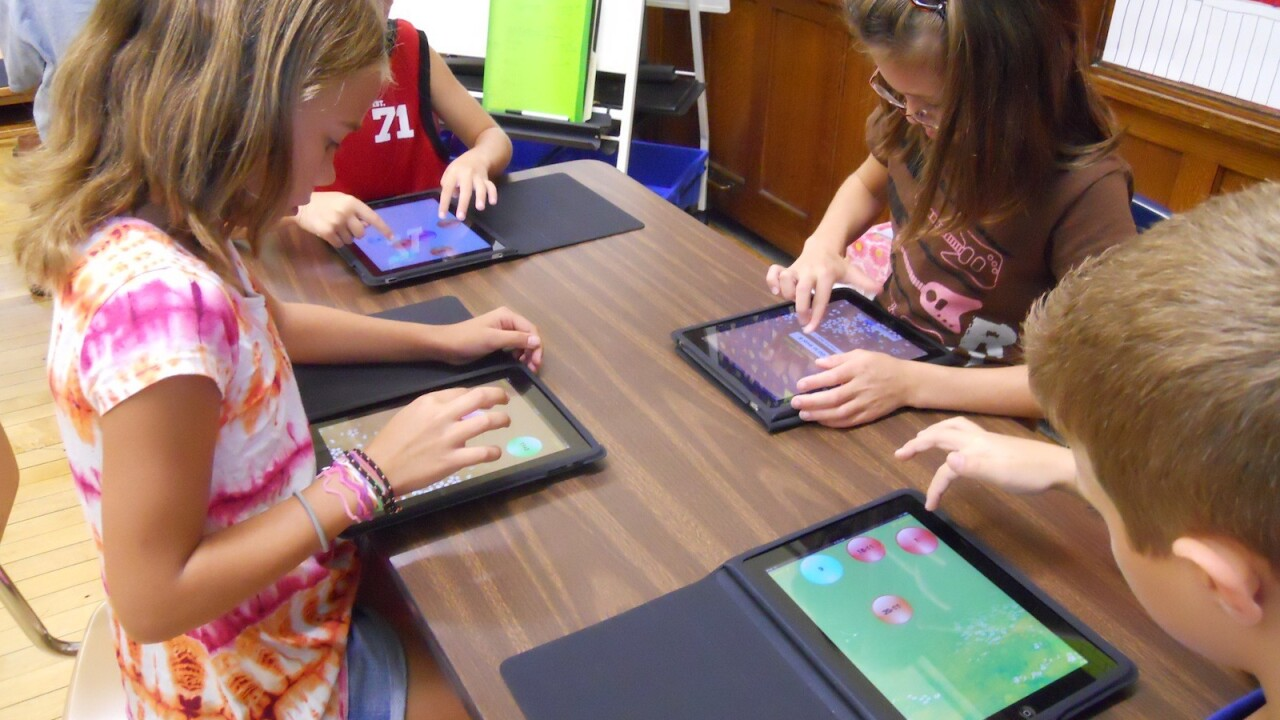 Apple's plan to get its products in schools? Educate the educators.