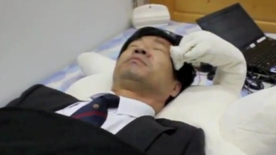This robotic teddy bear smacks you when you snore