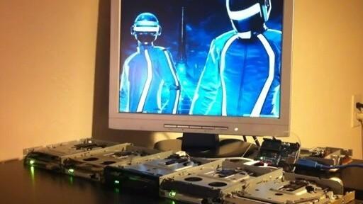 5 floppy disk drives drop a 120bpm break beat with Daft Punk's Derezzed