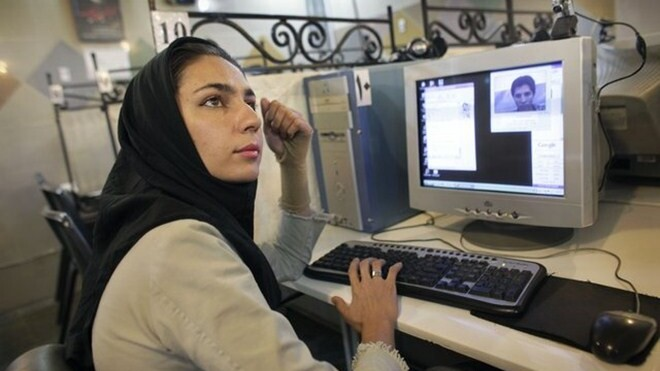 Iran monitors cyber cafe users as it tests 'closed' Internet alternative
