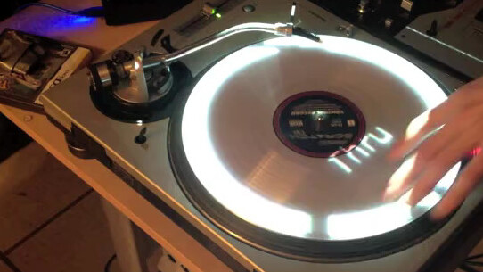 Projector mapping morphs a mixer and turntables into a DJ's dream GUI