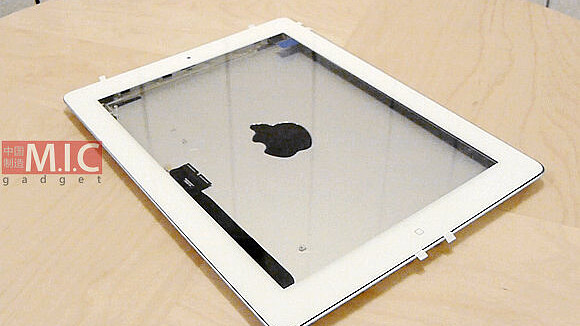 Parts that appear to be for iPad 3 assembled and tested with cases, including Apple's Smart Cover