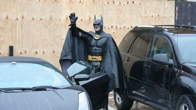 Batman gets pulled over by the police for not having a license plate on his Batmobile