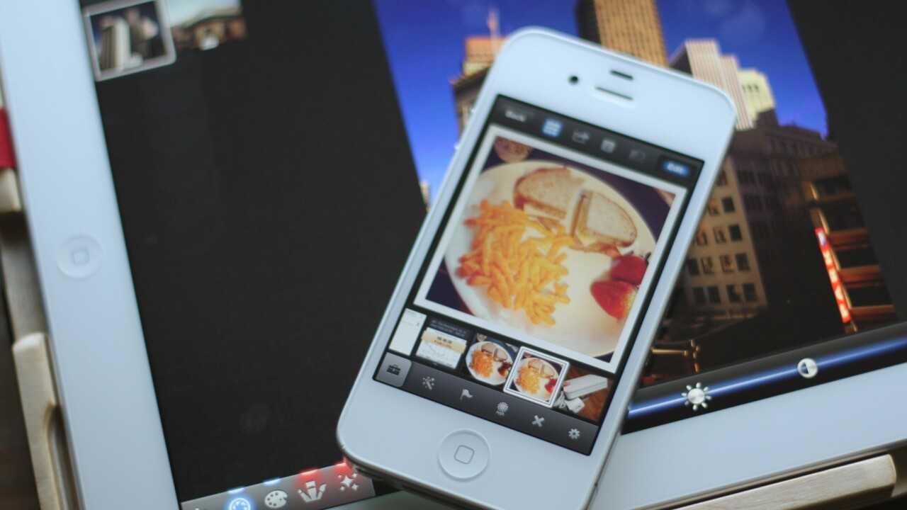The iPad is growing up, and iPhoto is its puberty