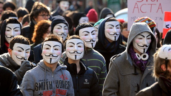 """Anonymous demands free access after Wikileaks adds """"paywall"""" for Stratfor Global Information Files"""