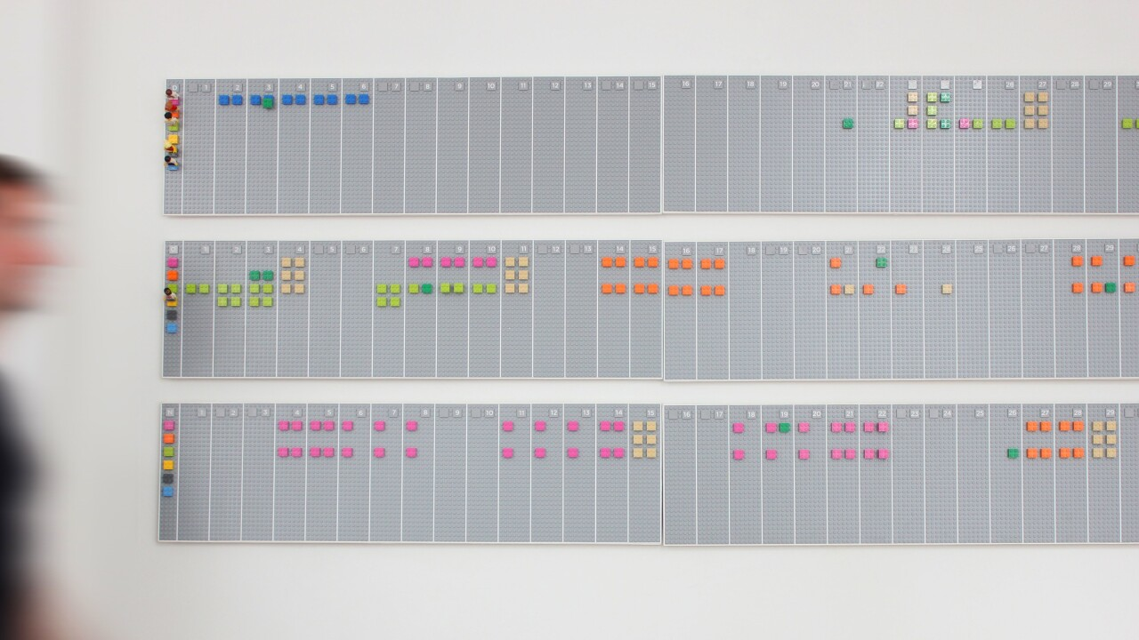 This awesome LEGO wall planner syncs digitally with your Google Calendar account