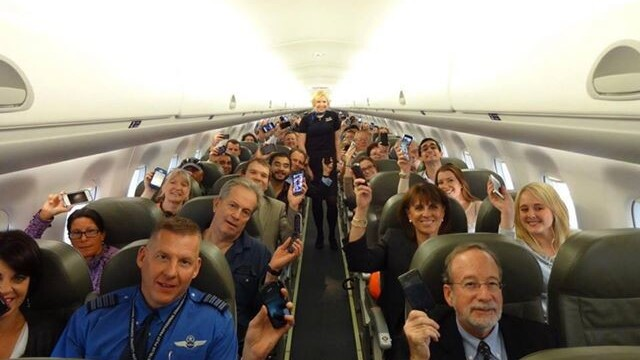 Good times. A photo of happy passengers from the first flight to allow gate-to-gate gadget use