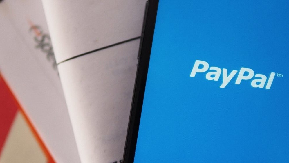 PayPal now lets some US firms bypass 4-day waits and transfer money to their bank accounts in 24 hours