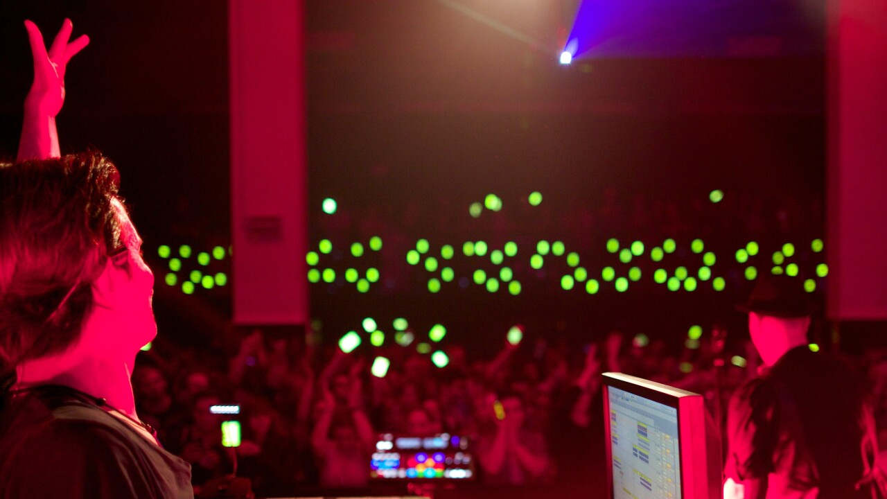 Dance music duo commandeer fans' smartphones to create a synchronized orchestra of sound and light