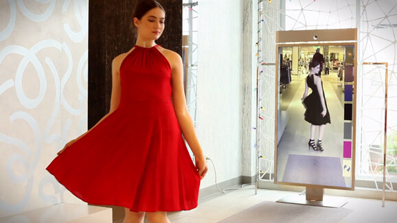 This smart mirror lets you try on different clothes without visiting the fitting room