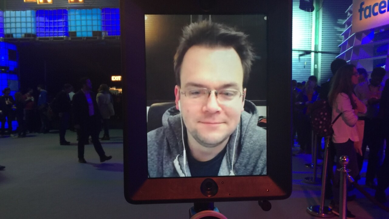This guy is staying up all night in California to drive a robot around a conference in Europe
