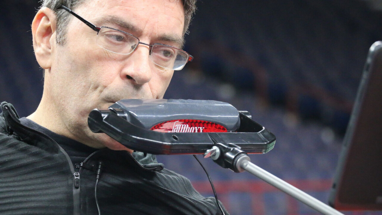 Paralyzed man invents hands-free instrument. Now he wants to play the anthem at a MLB game