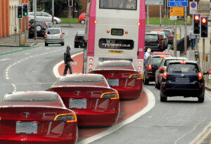 Electric vehicles can now use bus lanes in the UK — and cyclists aren't happy