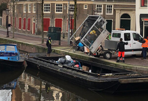 Amsterdam trials electric 'trash boats' to clean up its streets