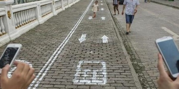 This Chinese city has special walking lanes for pedestrians who can't put their phones down