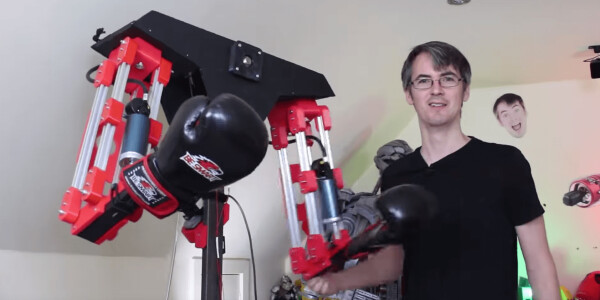 Mad scientist builds a robot to beat the crap out of him in a VR fighting game
