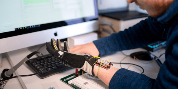 This robotic glove uses AI to help people with hand weakness regain muscle grip